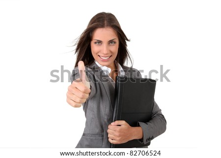 Portrait of young businesswoman showing thumb up - stock photo