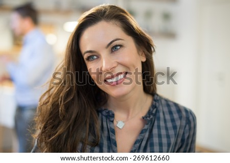 Portrait of young businesswoman smiling and looking away in office