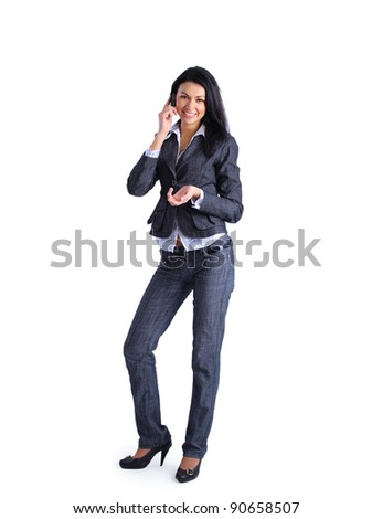 Portrait of young businesswoman talking on mobile phone  isolated on white background - stock photo