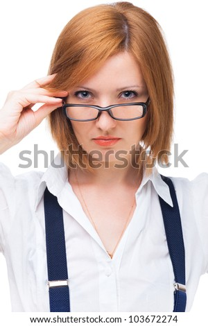 portrait of young businesswoman wearing glasses, with a serious face - stock photo