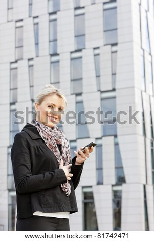 portrait of young businesswoman with a mobile - stock photo