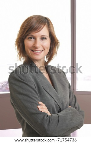 Portrait of young businesswoman with arms crossed