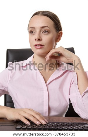 Portrait Of Young Businesswoman With Keyboard At Workplace
