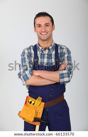 Portrait of young carpenter on white background