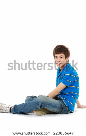 portrait of young Casual asian man sitting on the floor