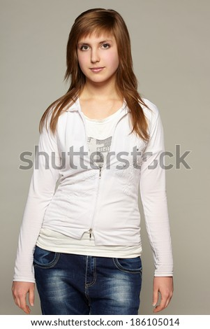 Portrait of young casual calm woman, front view - stock photo
