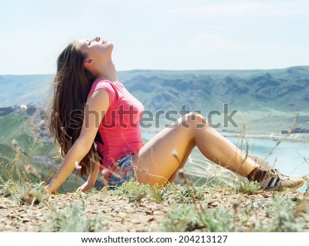 Portrait of young caucasian beautiful sport  women in summer nature on the background of river in blue pants