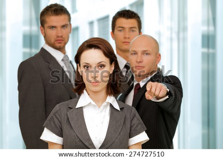 Portrait of young caucasian business people in office - stock photo