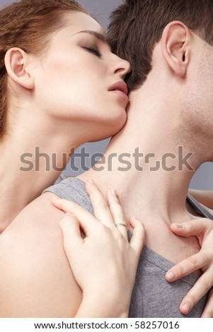 portrait of young caucasian couple on gray - stock photo