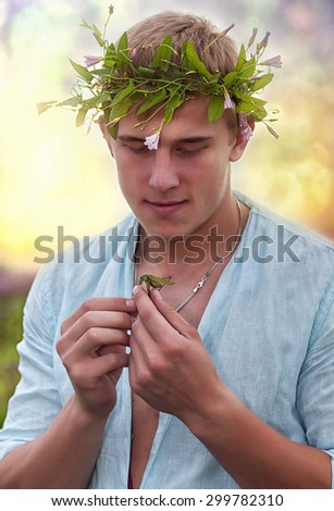 portrait of young caucasian man with grasshopper - stock photo
