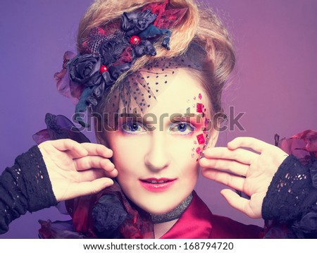 Portrait of young charming woman in artistic image.