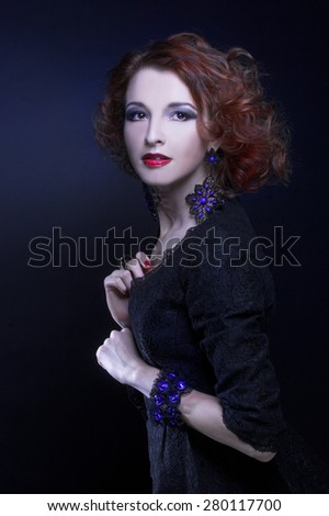 Portrait of young charming woman in black dress - stock photo
