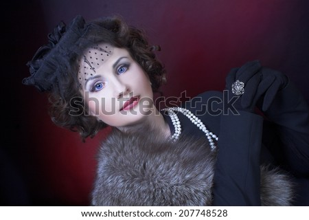 Portrait of young charming woman in elegant retro image. - stock photo