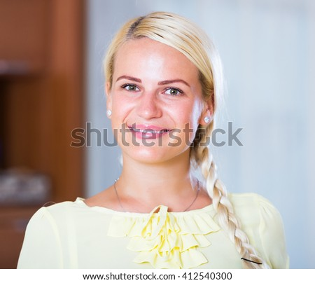 Portrait of young cheerful blonde woman - stock photo