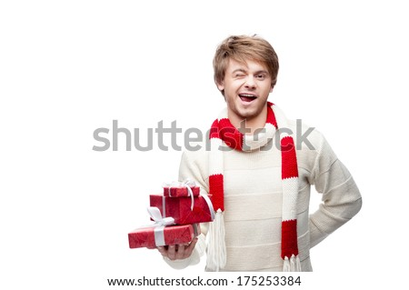 portrait of young cheerful caucasian man which holding christmas gift and winking - stock photo