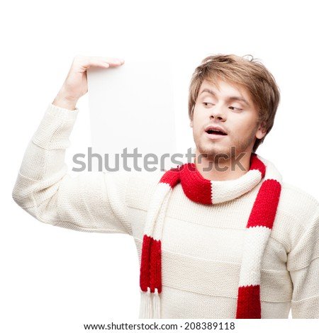 portrait of young cheerful caucasian man which holding sign on shoulder with funny expression - stock photo