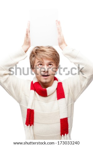 portrait of young cheerful caucasian man which holding sign over head with funny expression - stock photo