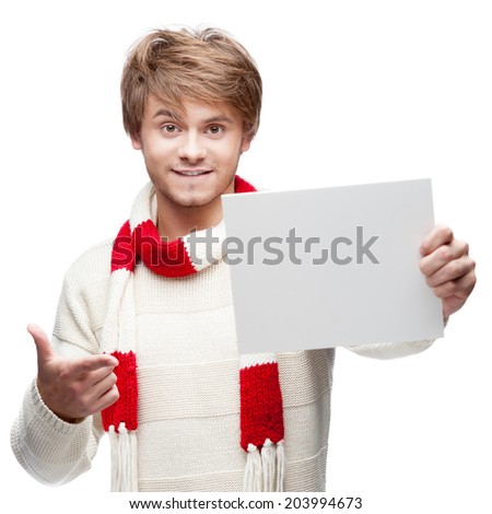 portrait of young cheerful caucasian man which pointing at sign with funny expression