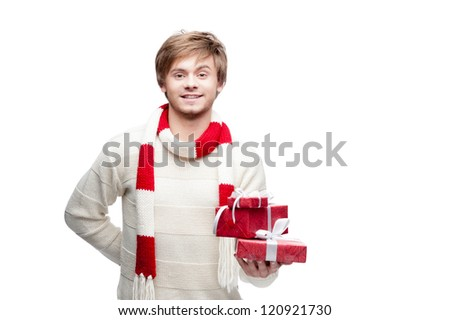 portrait of young cheerful smiling caucasian man which holding christmas gifts with happy smile