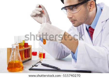 Portrait of young chemist mixing liquid chemical, isolated on white background
