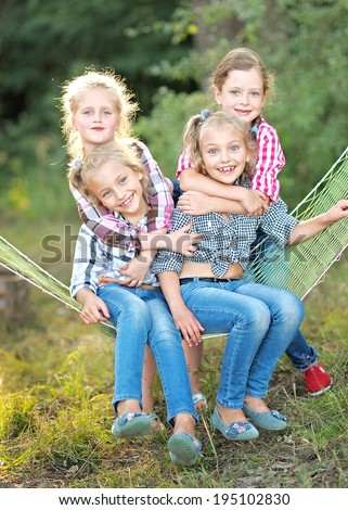 Portrait of young children on a camping holiday - stock photo