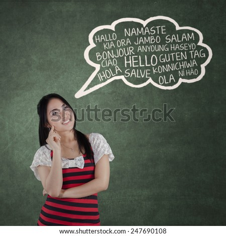 Portrait of young chinese woman studying multilingual in the class - stock photo
