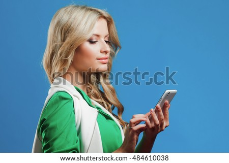 Portrait of young confident blonde, use the phone