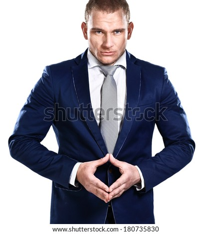 Portrait of young confident business man, isolated over white background - stock photo