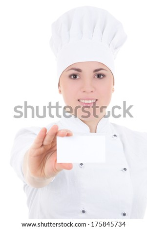 portrait of young cook woman in uniform showing visiting card isolated on white background - stock photo