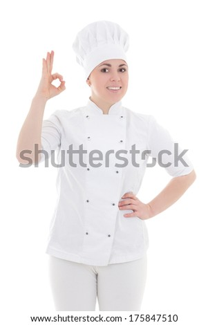 portrait of young cook woman showing ok sign isolated on white background