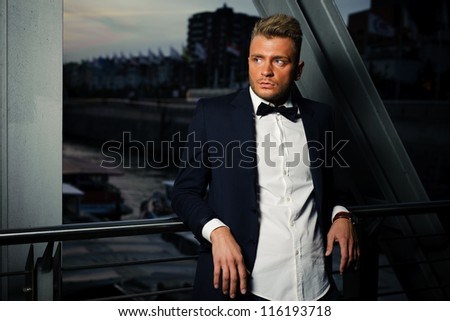 Portrait of young cool men waiting outdoor - stock photo