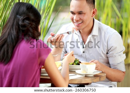 portrait of young couple have a romantic lunch together - stock photo