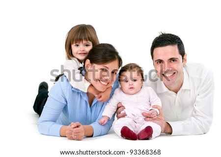 Portrait of young couple having fun with their daughters. Isolated on white background.