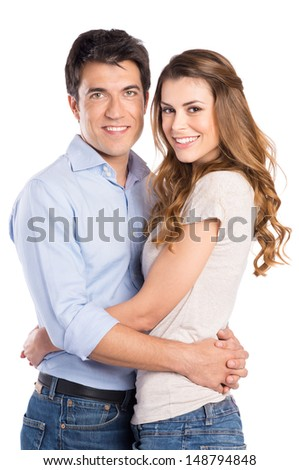 Portrait Of Young Couple Hugging Isolated On White Background - stock photo