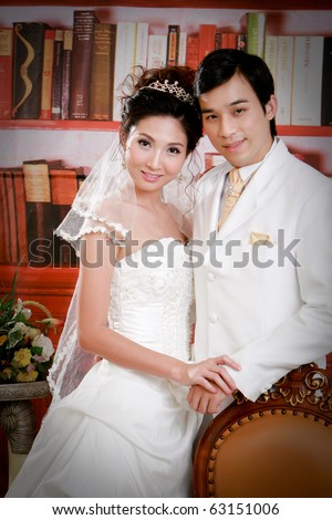 Portrait of young couple in elegant action - stock photo