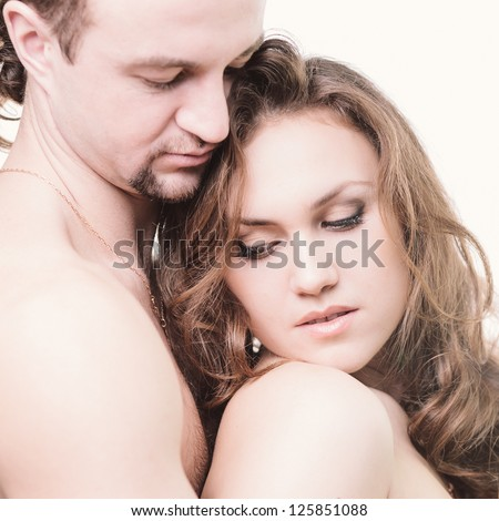 Portrait of young  couple in gentle relationship. High key