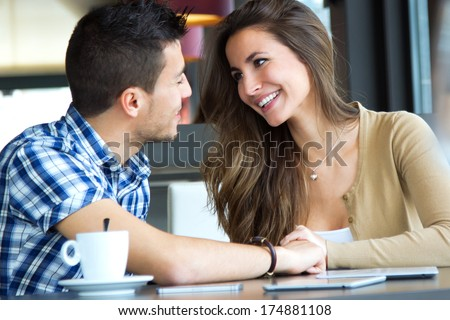 Portrait of young couple in love at a coffee shop - stock photo