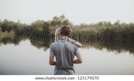 portrait of young couple in love outdoors - stock photo