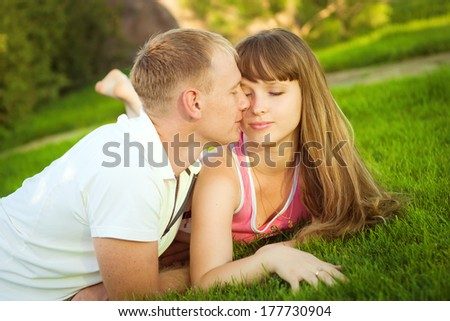 Portrait of young couple in love outdoors. Couple hugging in a park.