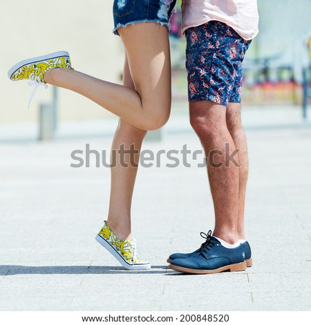 Portrait of Young couple in love, sensual kiss in the street - stock photo