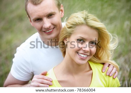 Portrait of young couple looking at camera outdoors