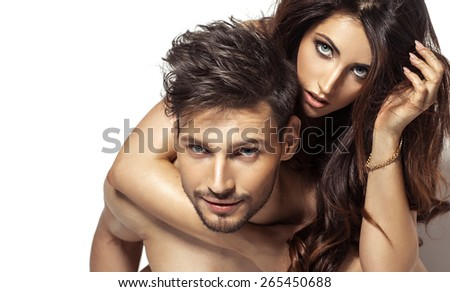 Portrait of young couple on white background - stock photo