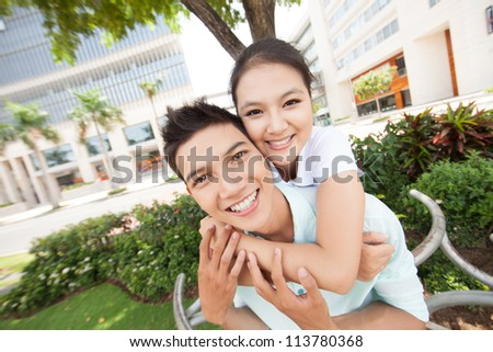 Portrait of young couple outdoors - stock photo