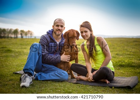 Portrait of young couple with a dog