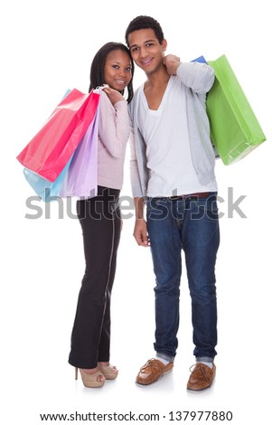 Portrait Of Young Couple With Shopping Bags Over White Background - stock photo