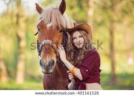 Portrait of young cowgirl and horse outdoors - stock photo