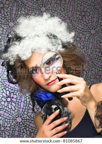 Portrait of young creative lady with magnifying glass