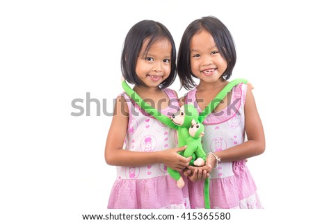 Portrait of young cute twin girl - stock photo