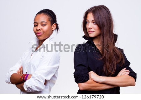 portrait of young different nationalities teenage girls, caucasian woman and african american woman - stock photo