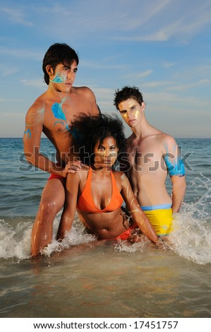 Portrait of young diverse group of friends on the beach